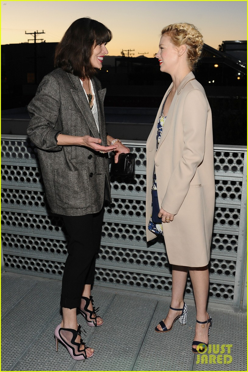 january jones milla jovovich coach evening of cocktails 102847361