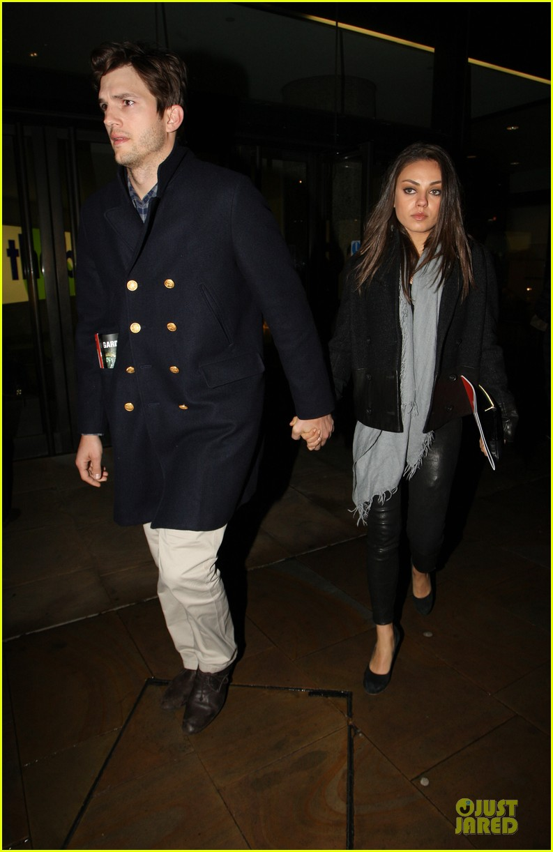 milia kunis ashton kutcher holding hands in london 02