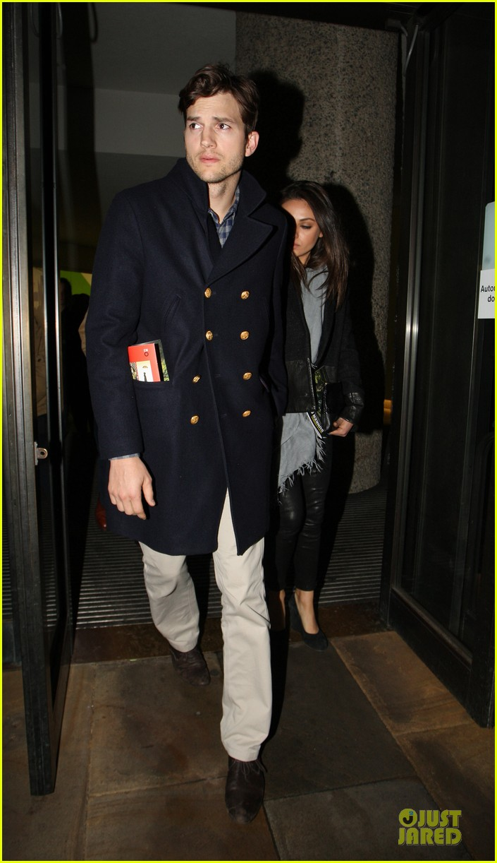 milia kunis ashton kutcher holding hands in london 06