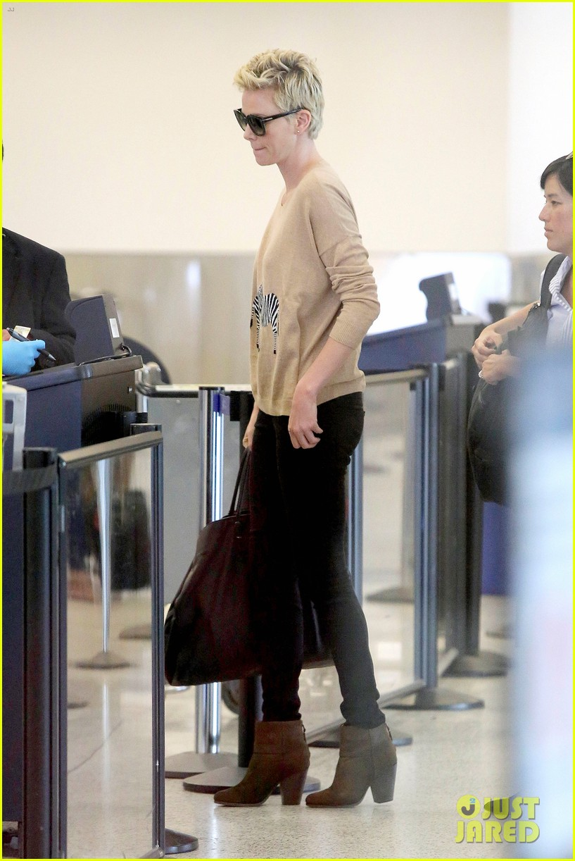 charlize theron zebra sweater at the airport 13