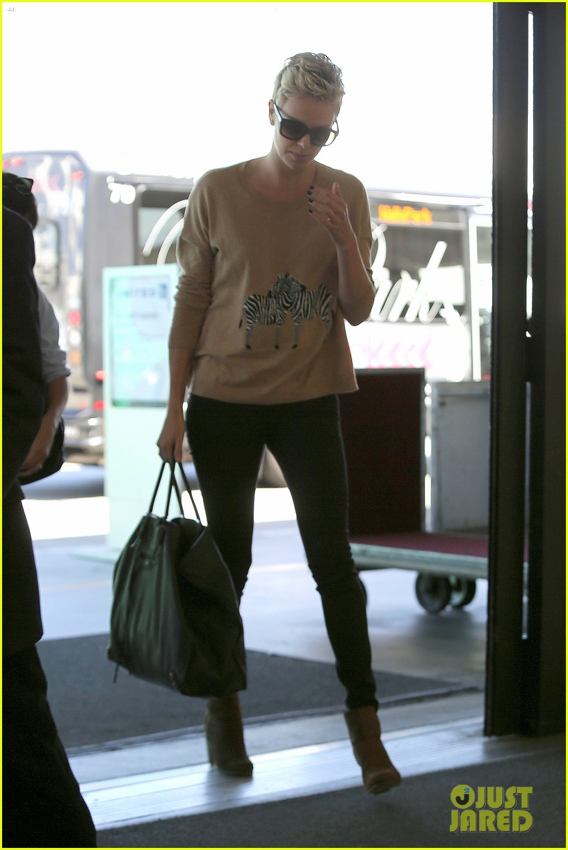 charlize theron zebra sweater at the airport 16