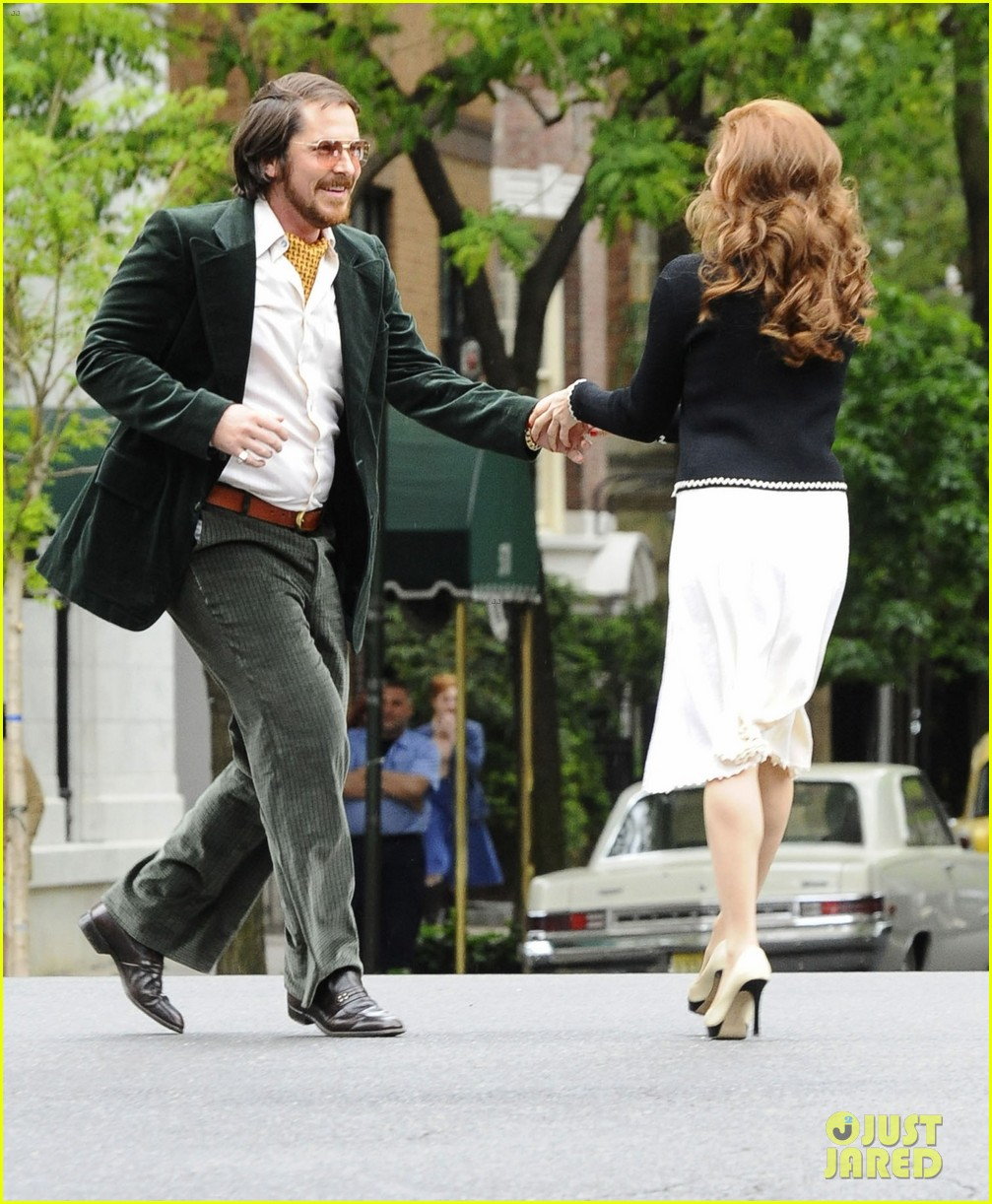 christian bale amy adams dance hold hands on set 01