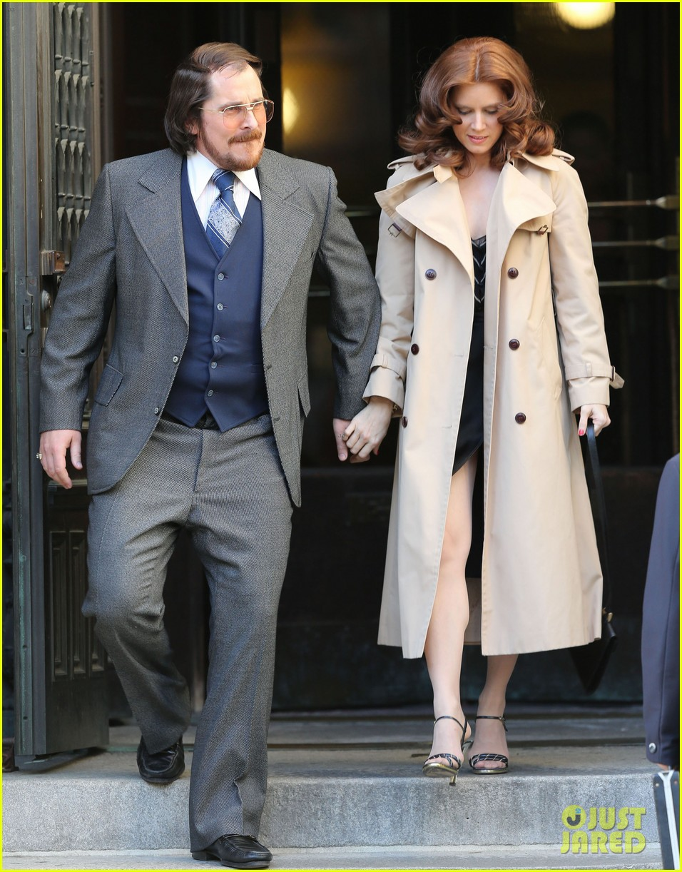 christian bale amy adams dance hold hands on set 122873350