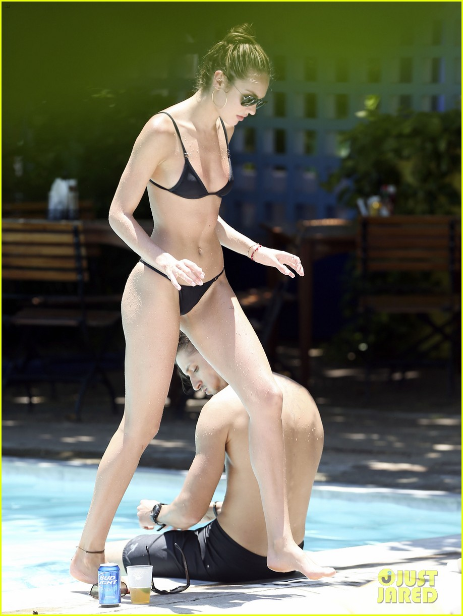 candice swanepoel poolside bikini babe  with hermann nicoli 152878440