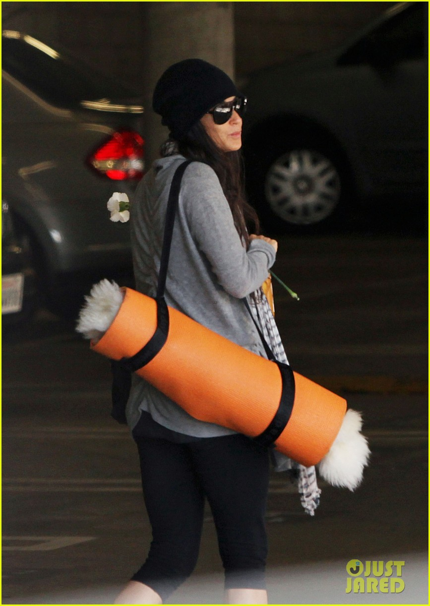 demi lovato carries a white rose out of yoga class 17