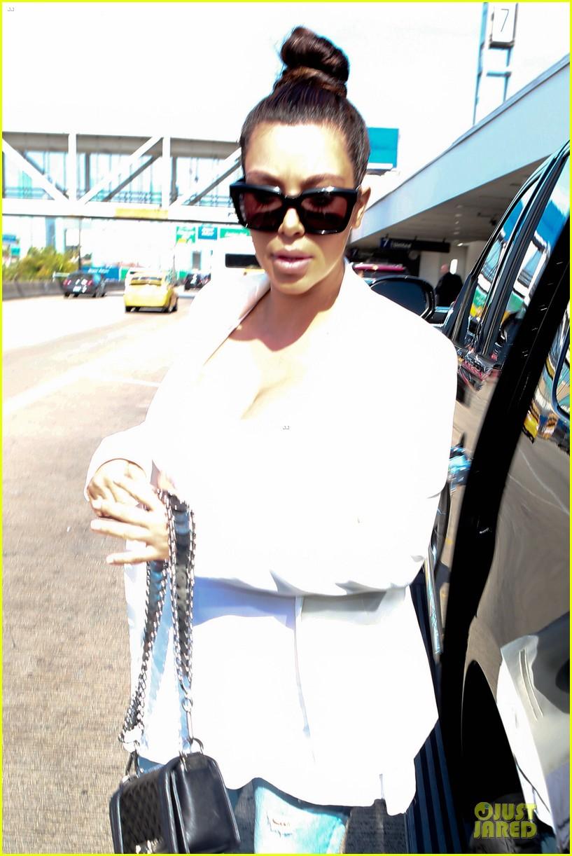 kim kardashian jetlagged flight with kourtney khloe 02