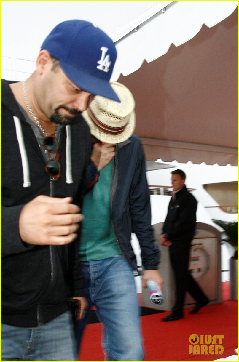leonardo dicaprio hides face after clubbing at cannes 03