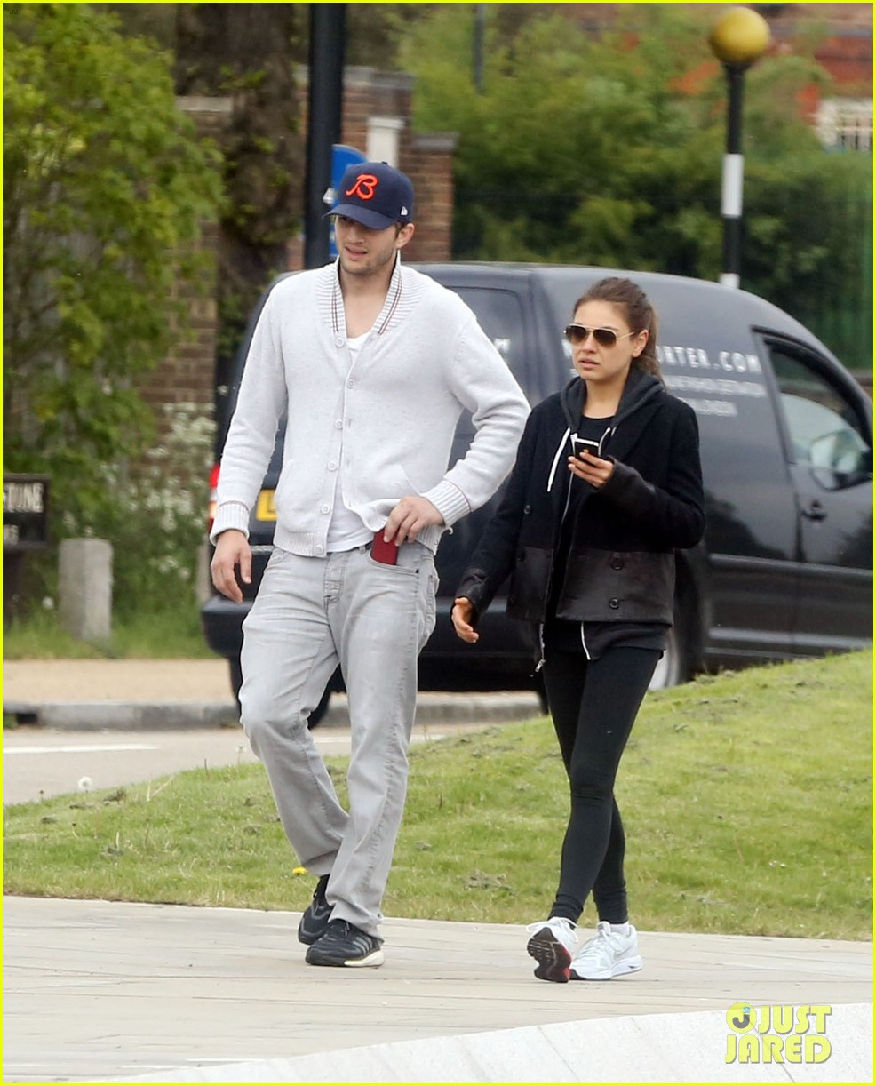 mila kunis ashton kutcher hold hands on london stroll 032873621