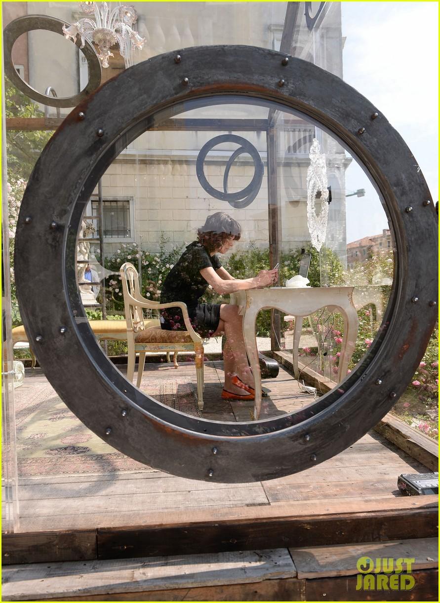 milla jovovich performs in plexiglass for international art exhibition 11