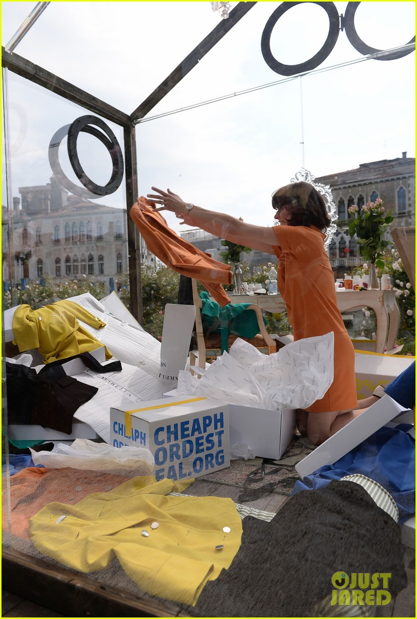 milla jovovich performs in plexiglass for international art exhibition 14