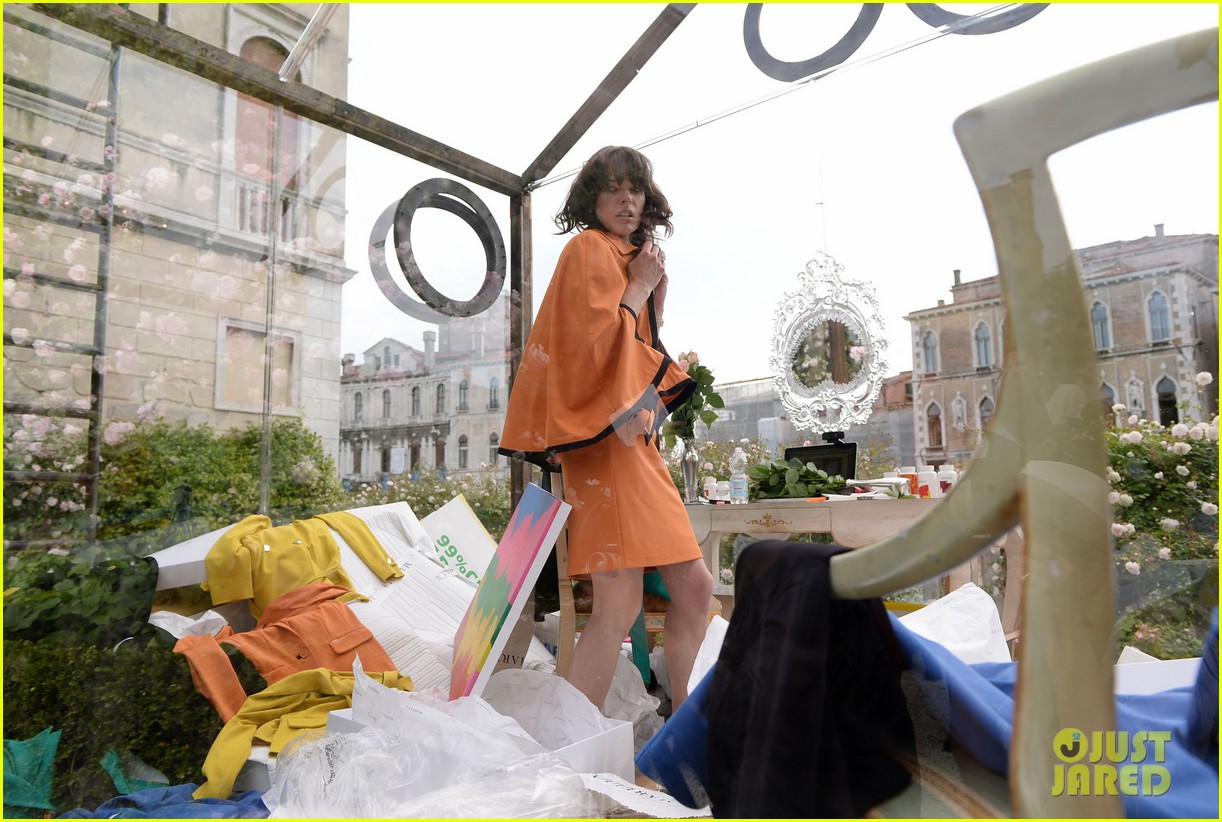 milla jovovich performs in plexiglass for international art exhibition 15