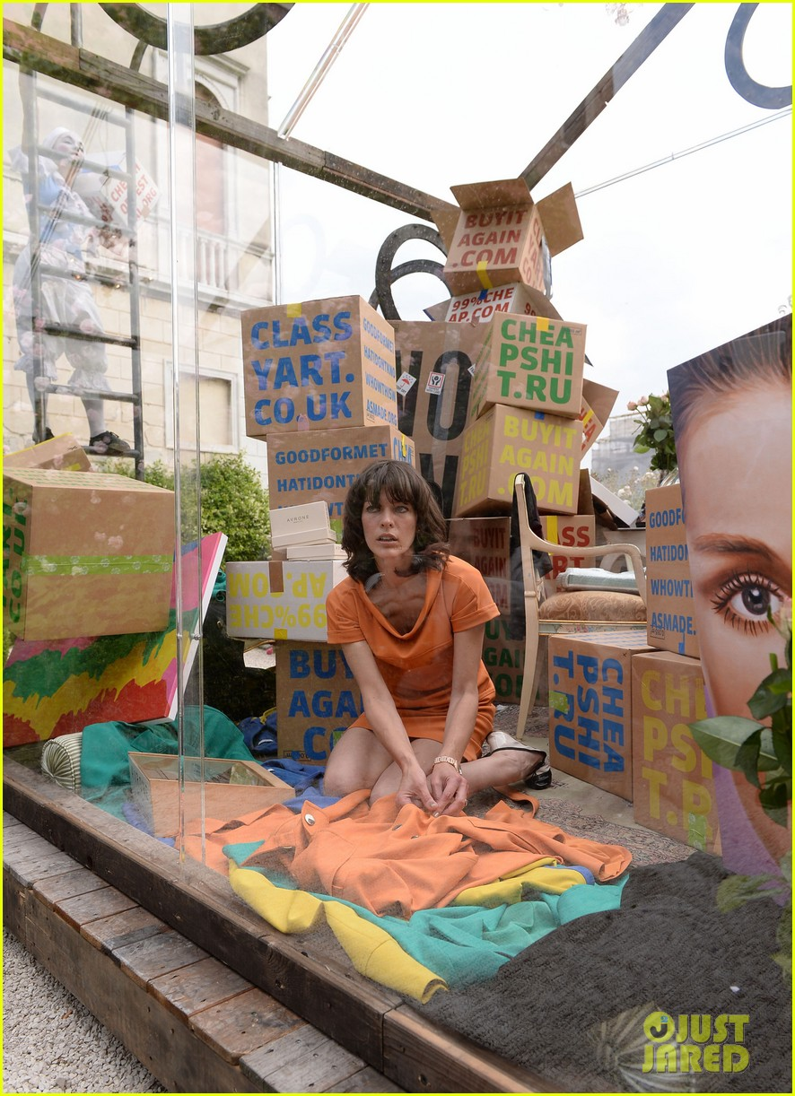 milla jovovich performs in plexiglass for international art exhibition 18