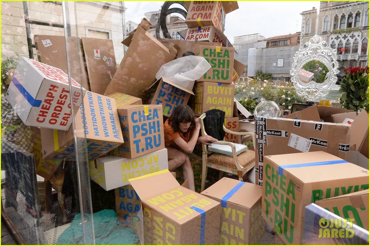 milla jovovich performs in plexiglass for international art exhibition 212879940