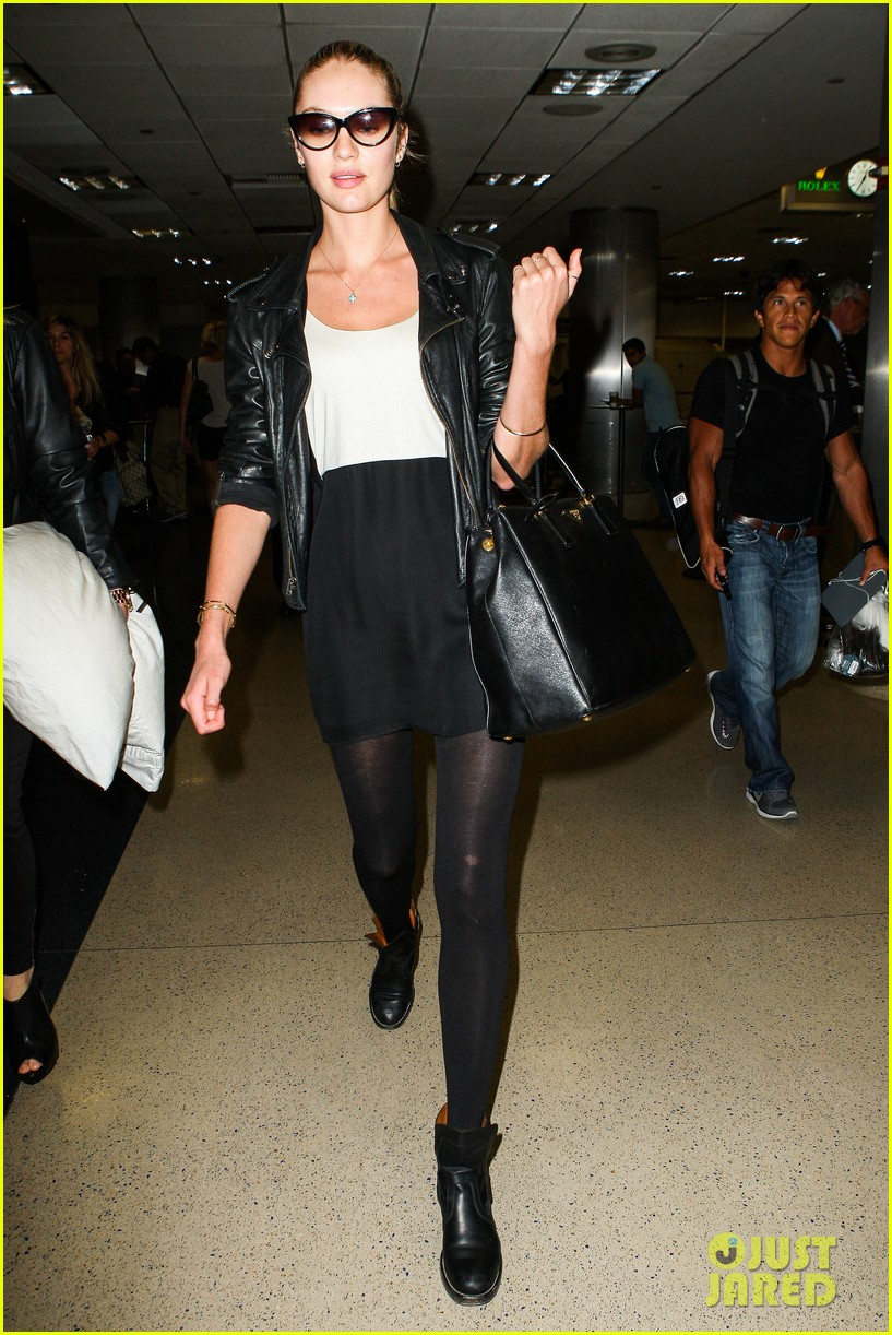 behati prinsloo poses for photo shoot candice swanepoel arrives at lax 10