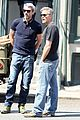 george clooney greets fans on monuments men set 12