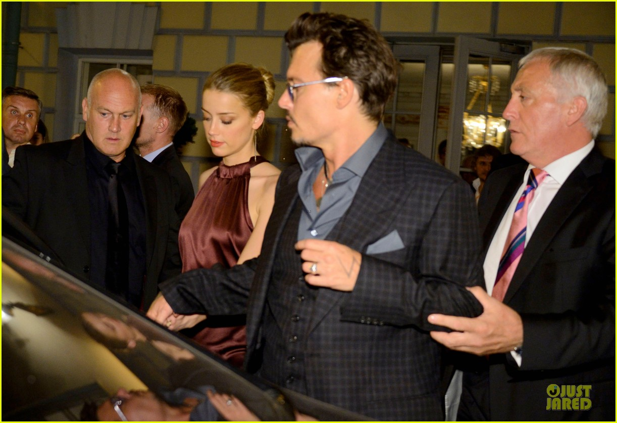 johnny depp amber heard hold hands after lone ranger premiere 02