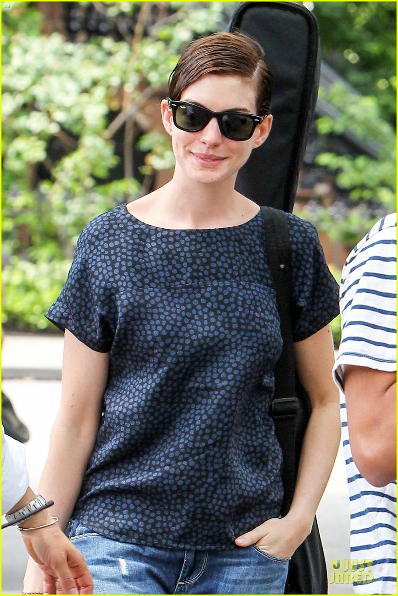 anne hathaway guitar carrying gal on song one set 152890159