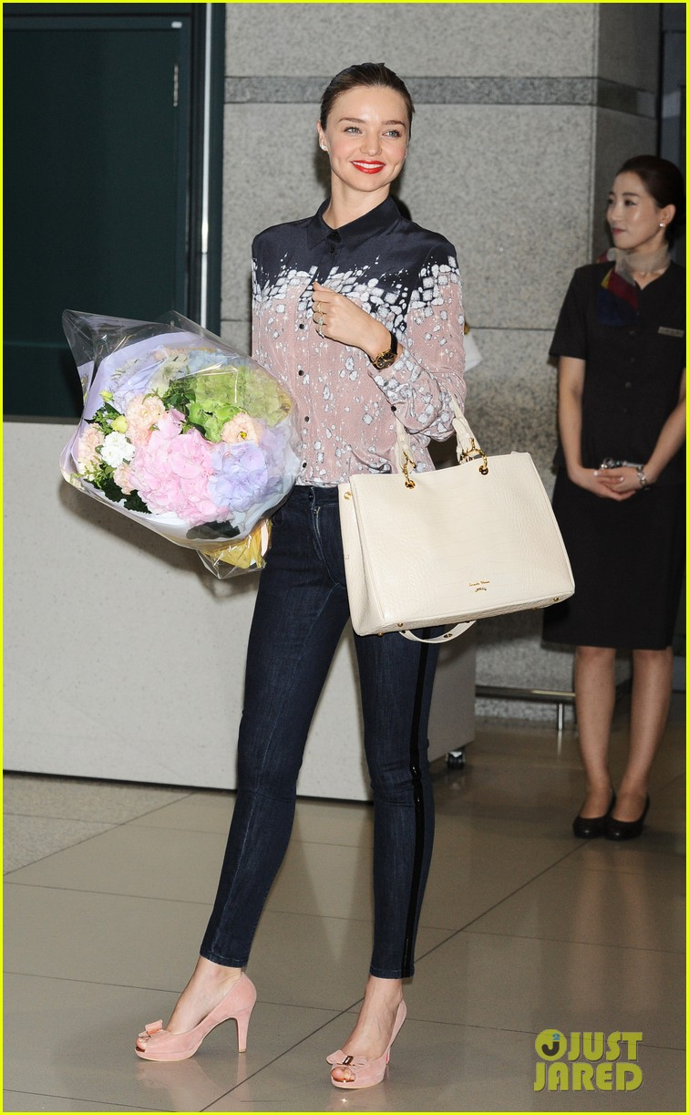 miranda kerr gets flowers upon arriving in south korea 05
