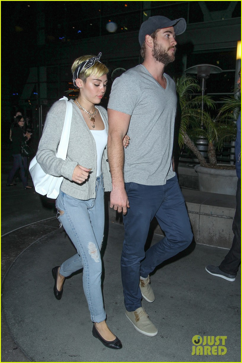 Miley Cyrus & Liam Hemsworth Hold Hands on Movie Date ...
