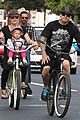pink carey hart bike riding with willow 15