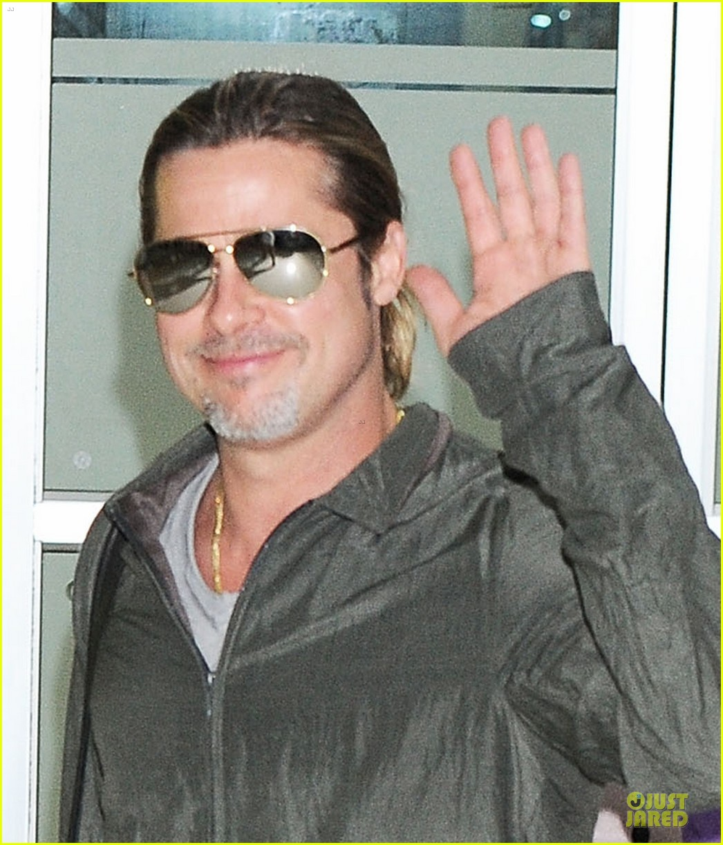 brad pitt pax south korea arriving father son duo 022888671