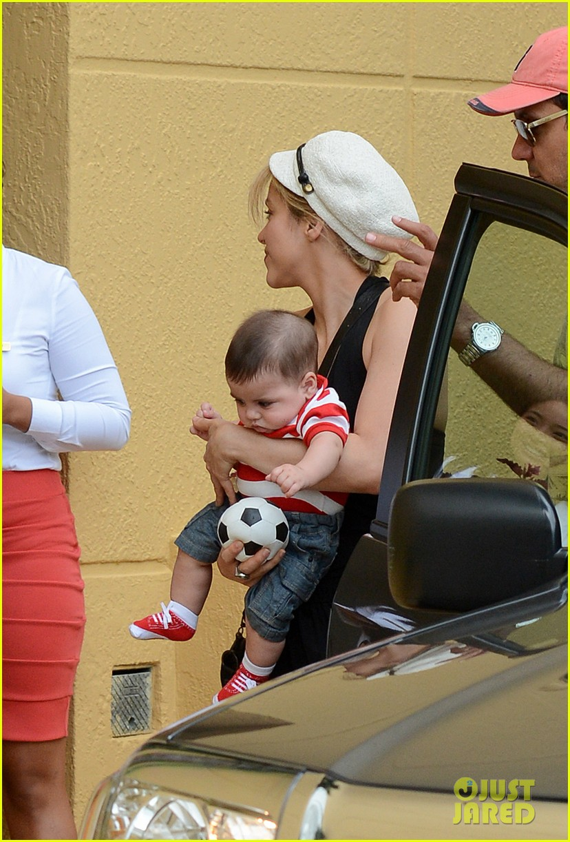 shakira carries toy soccer ball for baby milan 04