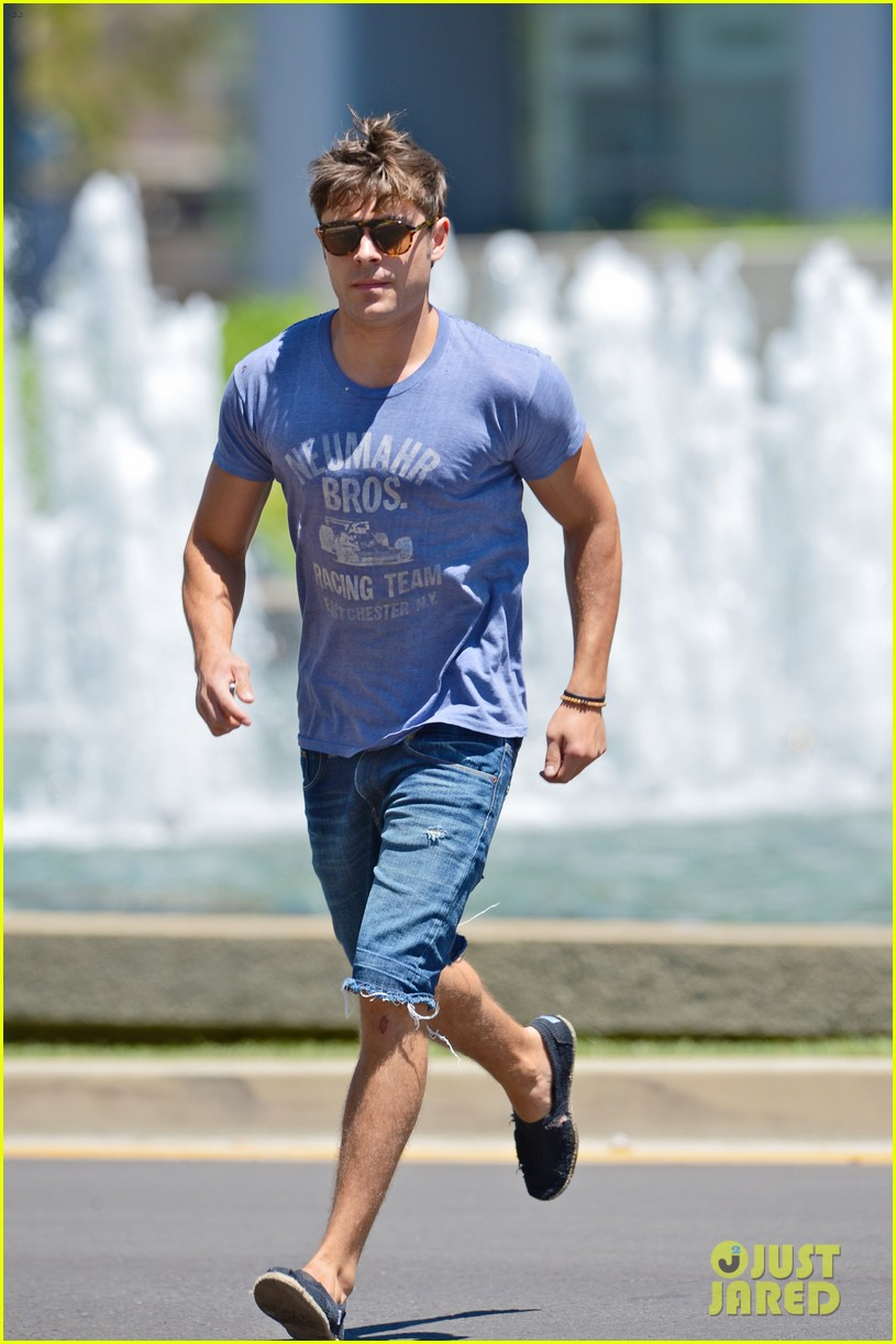zac efron leaps into action for hotel entrance 01