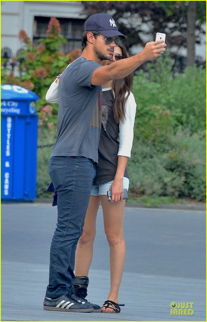 taylor lautner marie avgeropoulos holding hands as new couple 02