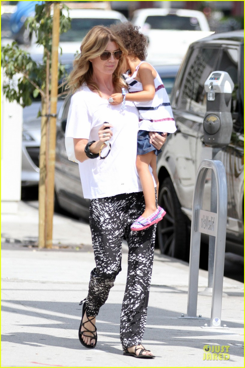 ellen pompeo showcases arm strength with stella 082917999