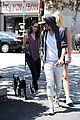 kristen stewart bra revealing walk with new puppy 18