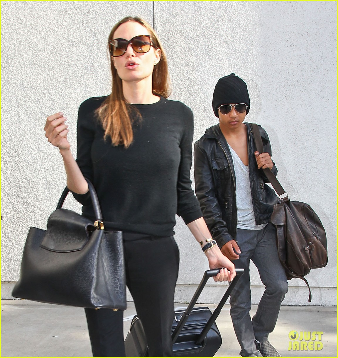 angelina jolie lands in los angeles with maddox 08