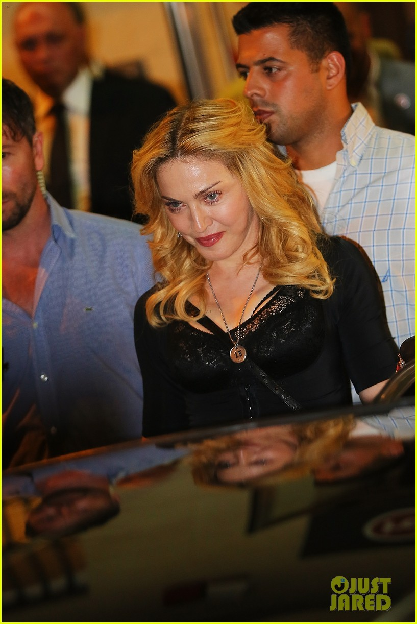 madonna rocks gold grills at the hard candy fitness center 092935302