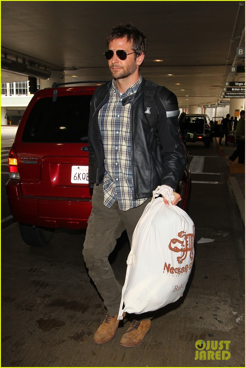 bradley cooper lands back home after press tour in spain 012949254