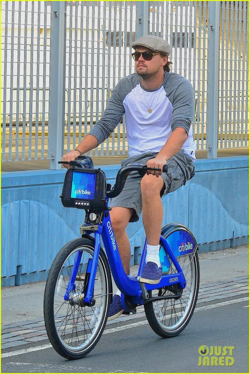 leonardo dicaprio rides a bike toni garrn parties for mademoiselle c 01