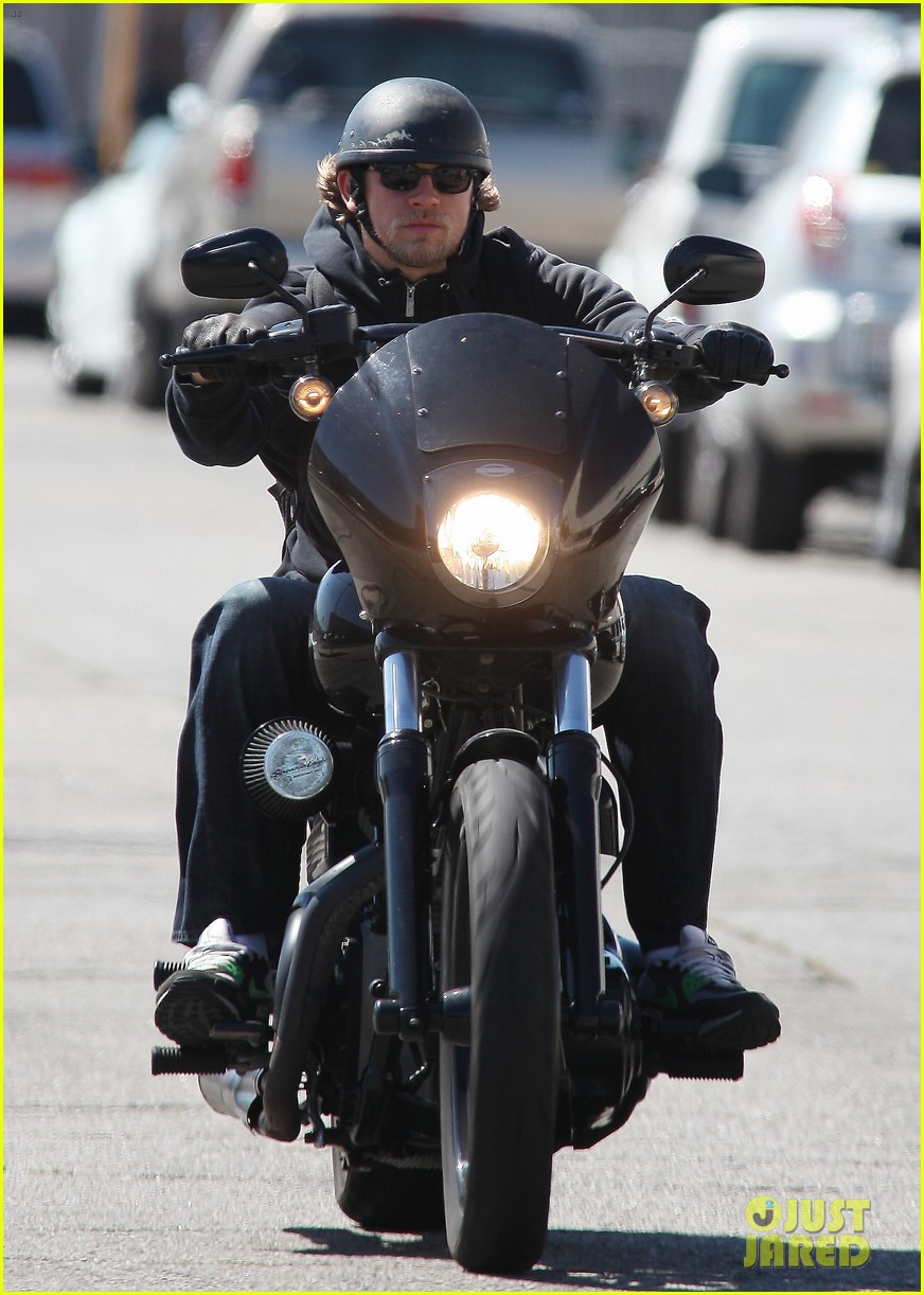 charlie hunnam rides motorcycle to work on 39 sons of. Black Bedroom Furniture Sets. Home Design Ideas