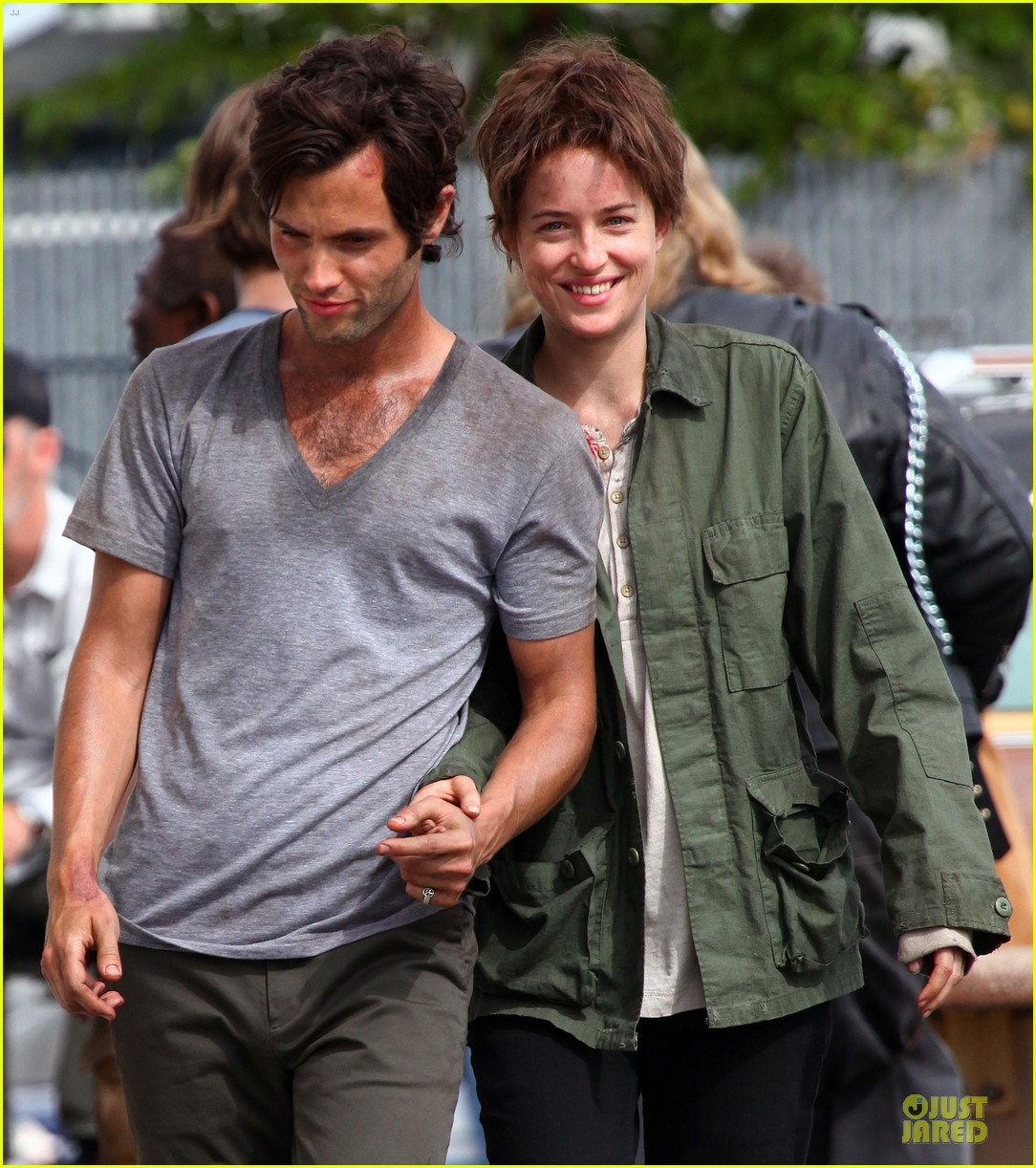 dakota johnson penn badgley hold hands for cymbeline 02