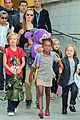 angelina jolie arrives in syd with all six kids 03