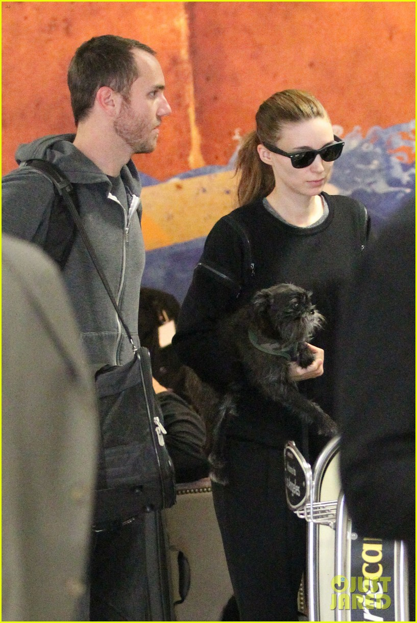 rooney mara holds pet pooch close at the airport 04