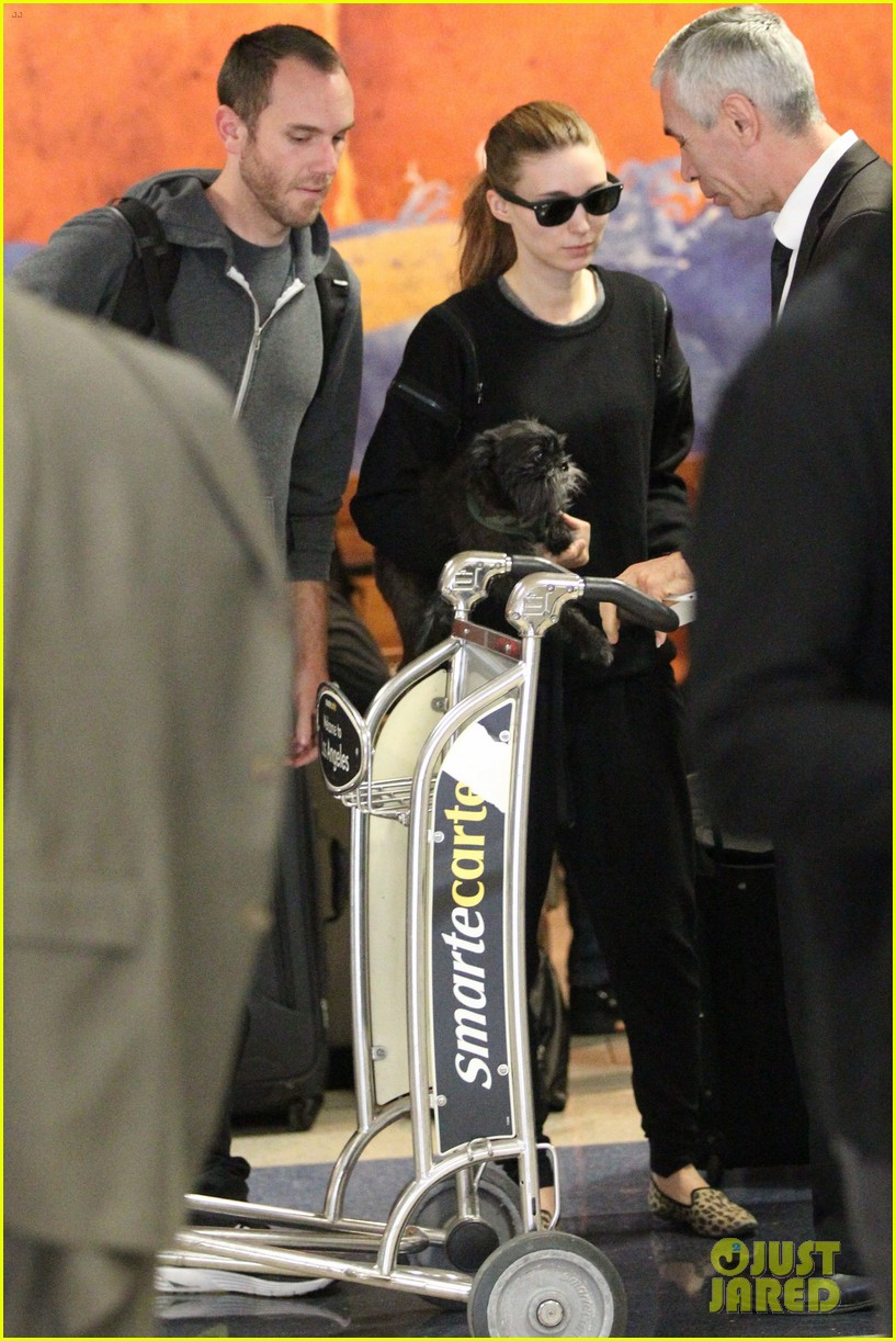 rooney mara holds pet pooch close at the airport 07