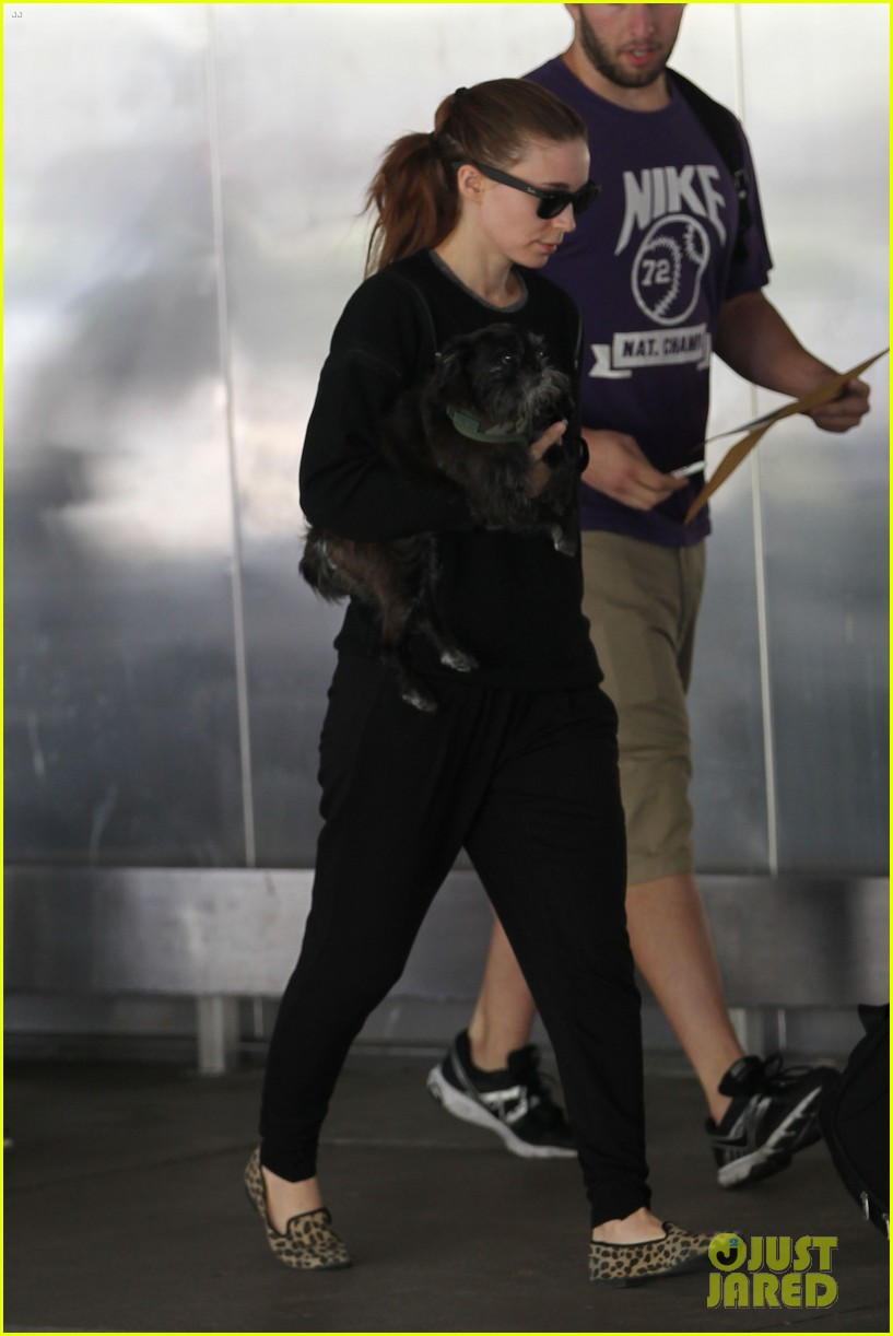 rooney mara holds pet pooch close at the airport 09