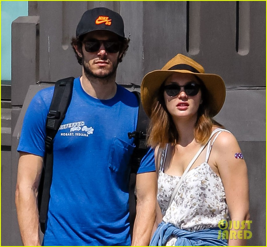 leighton meester adam brody hand holding stroll in soho 012950730
