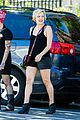 elisabeth moss wears leather shorts for film shoot 03