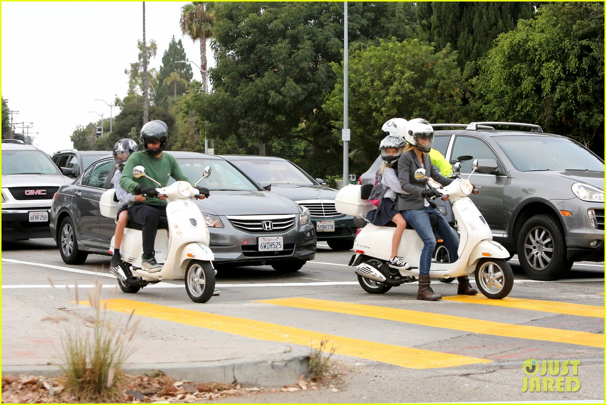 gwyneth paltrow chris martin side by side scooter rides 02