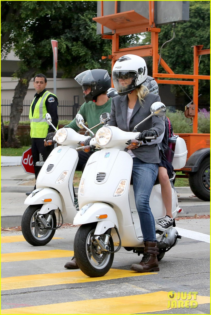 gwyneth paltrow chris martin side by side scooter rides 04