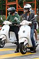 gwyneth paltrow chris martin side by side scooter rides 07