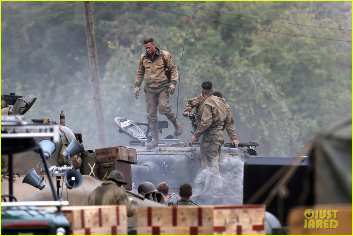 brad pitt rocks slicked back hair army outfit on fury set 03