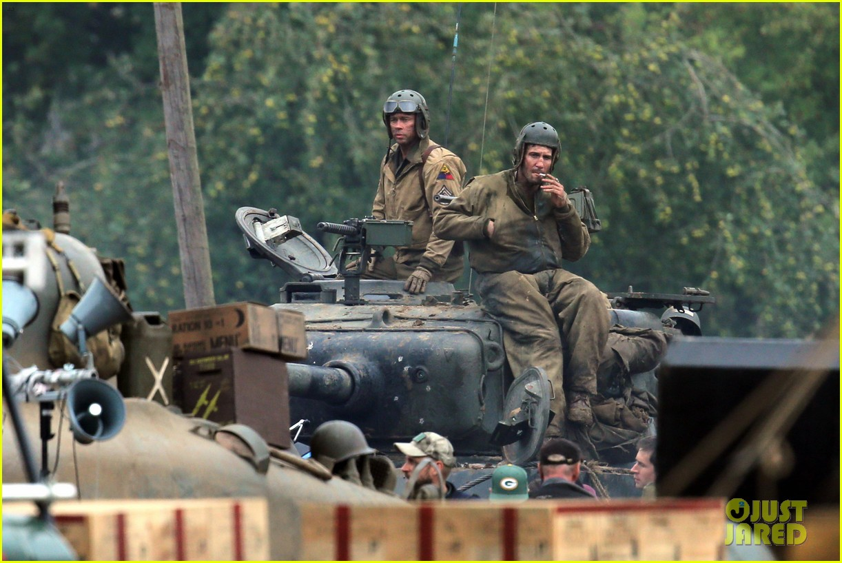 brad pitt rocks slicked back hair army outfit on fury set 06