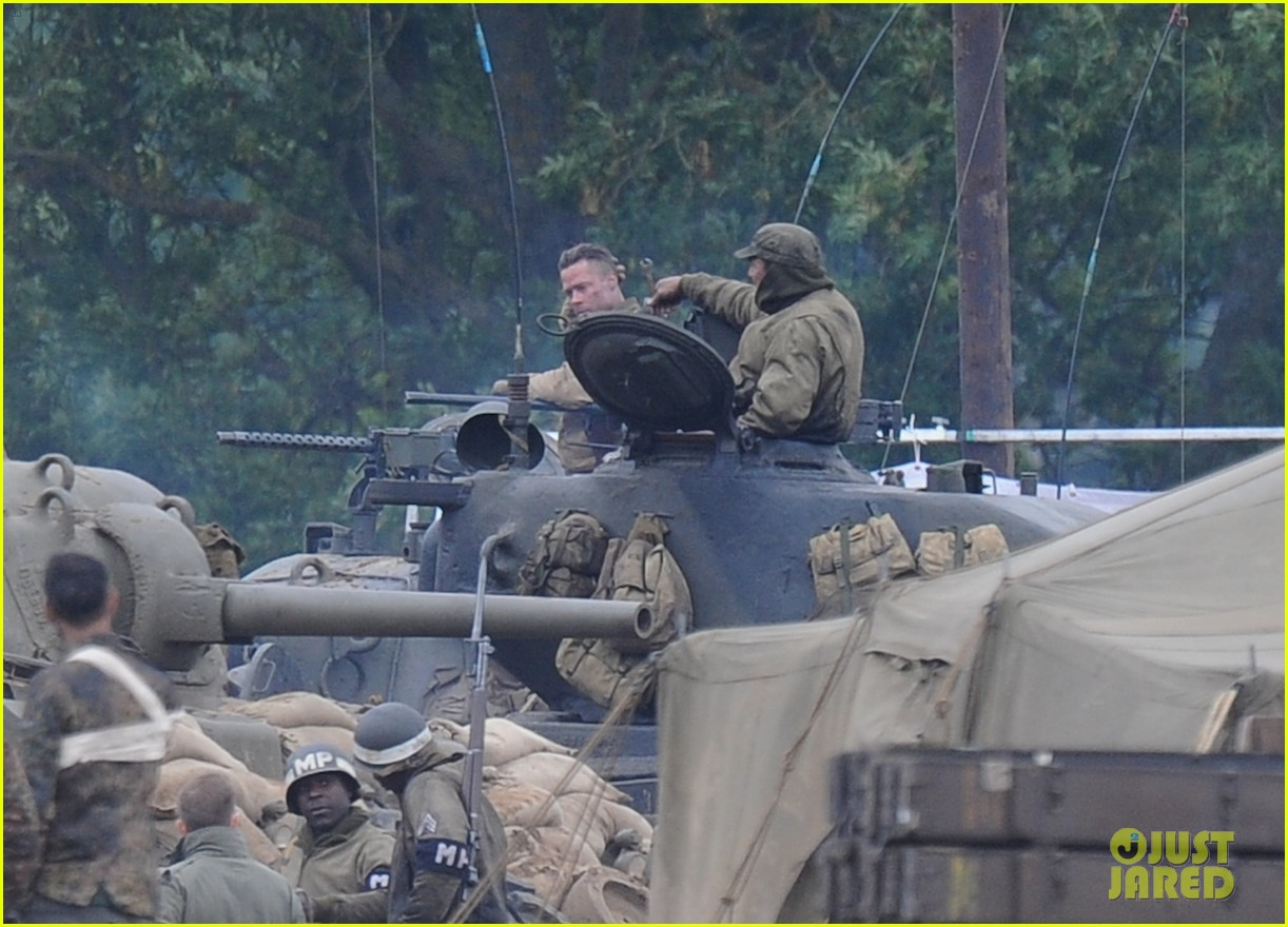 brad pitt rocks slicked back hair army outfit on fury set 14