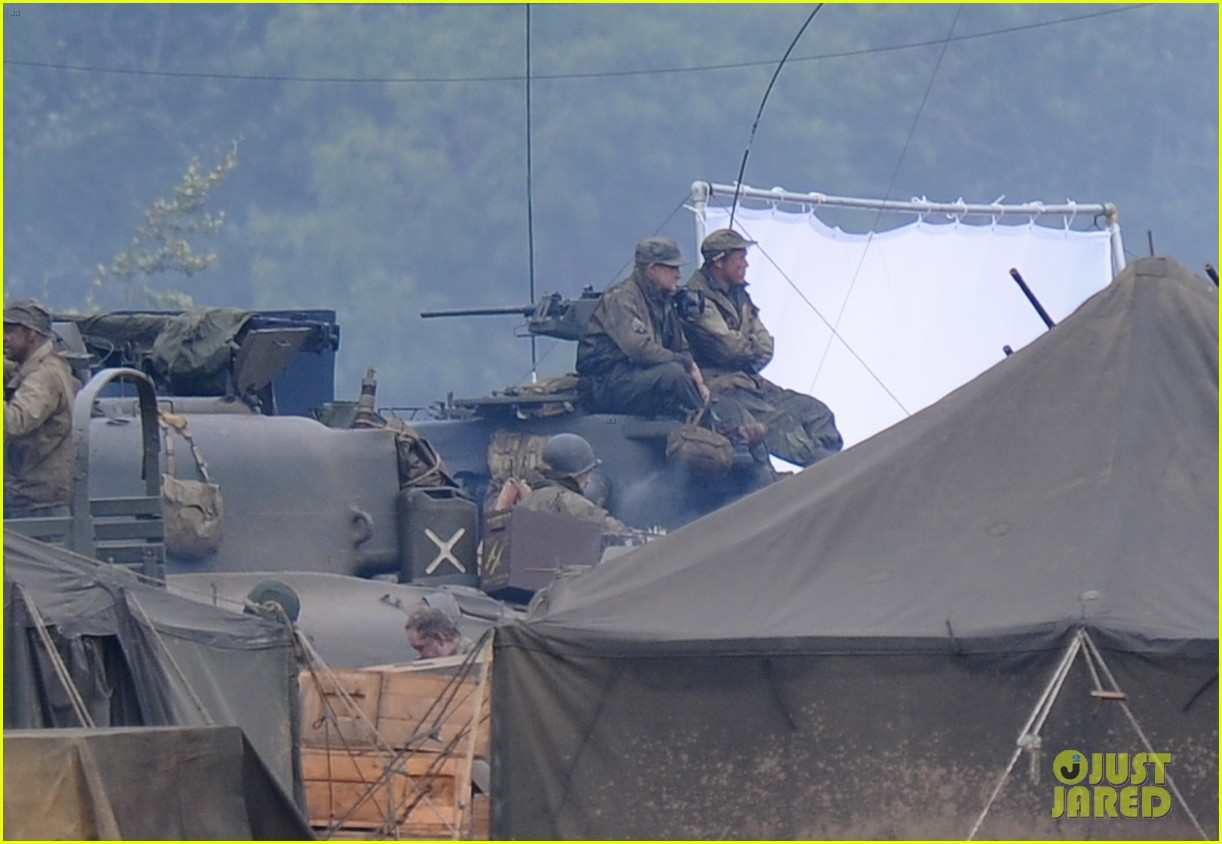 brad pitt rocks slicked back hair army outfit on fury set 27
