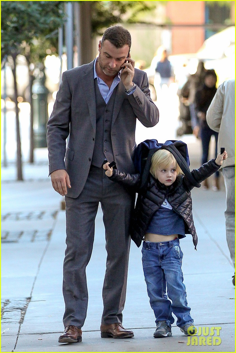 liev schreiber suits up for bike ride with his boys 11